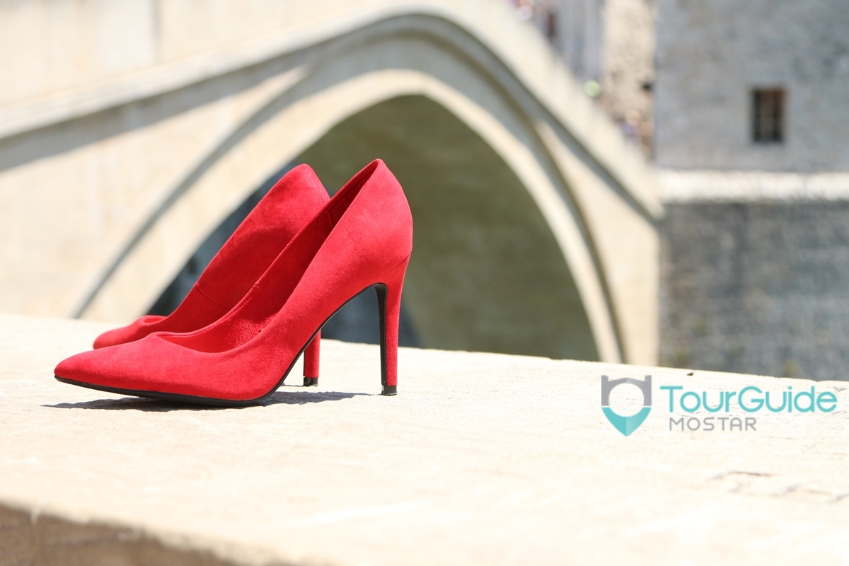 walking-in-heels-on-old-bridge-mostar