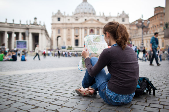 pretty-young-female-tourist-studying-a-map-at-st-peters-square